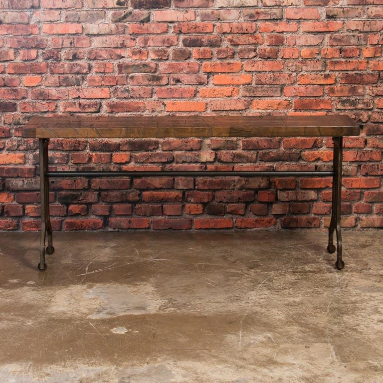 This console table has a strong aesthetic appeal due to the combination of the rich, maple top and the aged, Industrial legs. The table is made in the USA from reclaimed maple railroad box car flooring that show years of use and wear while the cast