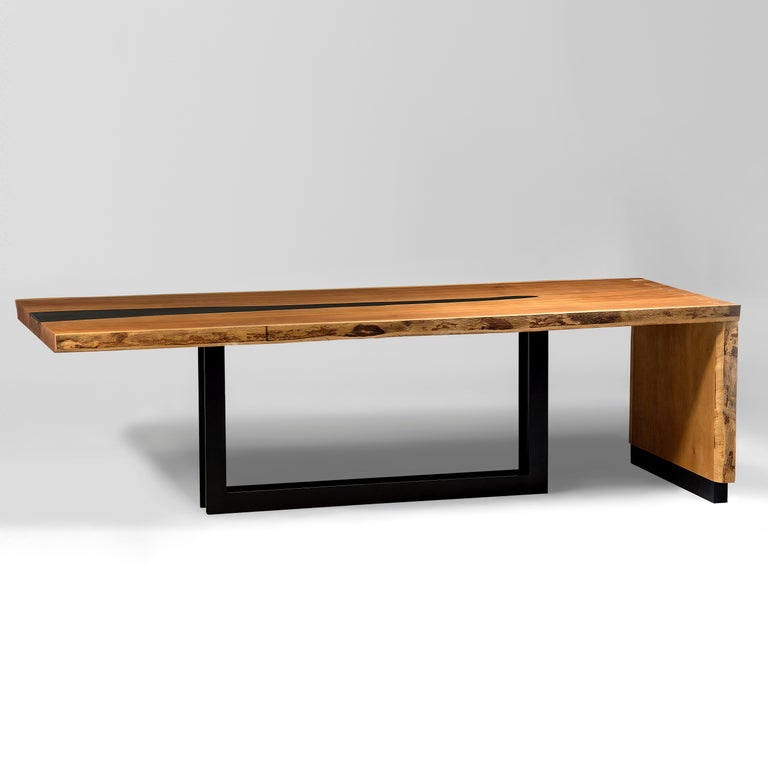 The Tala dinner table is the result of the industrial design aesthetic combined with contemporary styling. Innovating with its unique shape and manufactured with traditional woodwork techniques, the Tala table is perfect for dining rooms and will