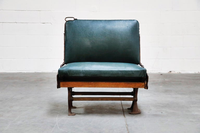 This Brooklyn Trolley bench is reversible, simply grab the cast iron handle and lift, easily pivots from side to side so you can change the direction of your conversation and view with ease. Featuring its original leatherette upholstery, detailed