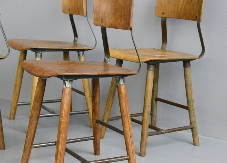 Industrial factory chairs by Rowac, circa 1930s  - Price is per chair (4 available) - Steel and Beech frame - Ply seat and back rest - Relief