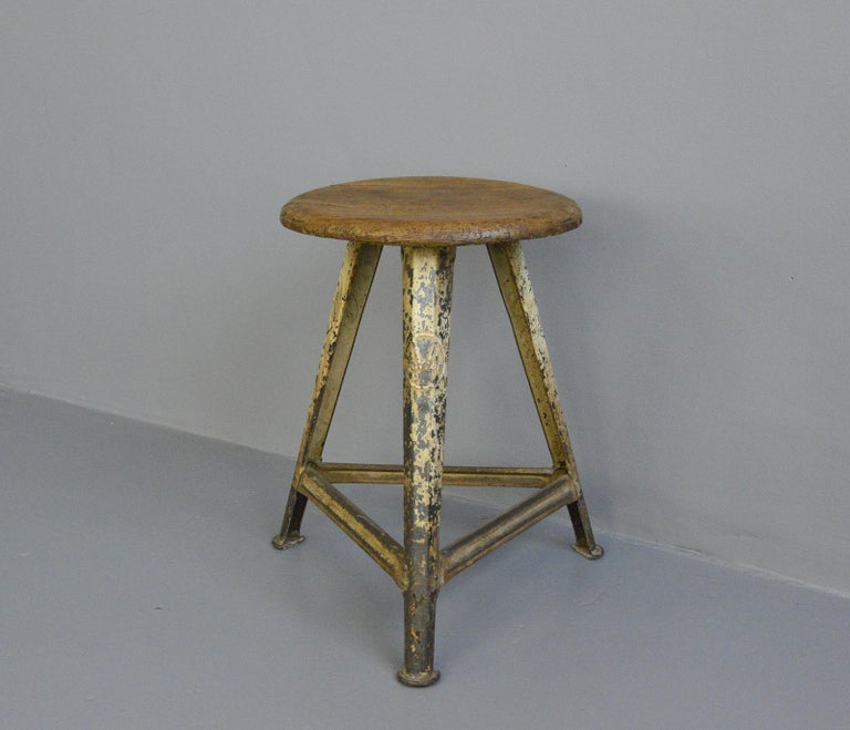 Industrial factory stool by Rowac, circa 1920s  - Original crackled cream paint - Branded on all 3 legs - By Robert Wagner, Chemnitz - German, 1920s - Measures: 51cm tall  Rowac  Robert Wagner's founded his company in 1888 in Chemnitz,