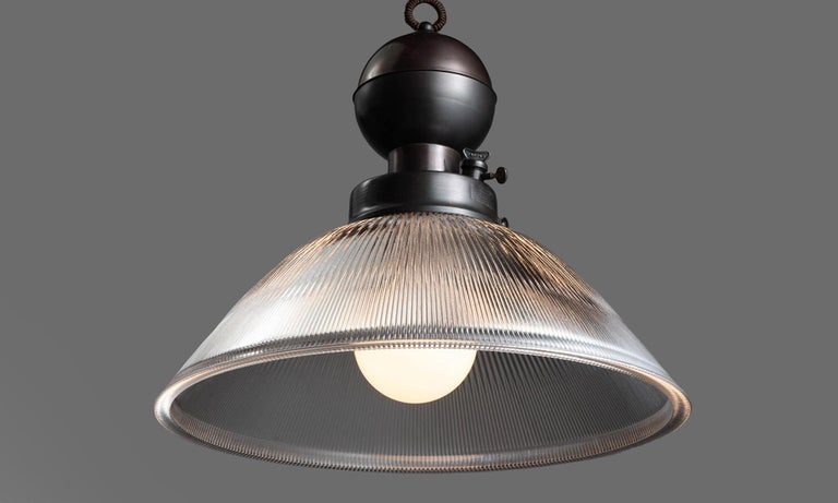 Industrial glass and brass gas lamp pendant, Italy, 21st century.  In the style of an Industrial gas lamp pendant, converted to electric.