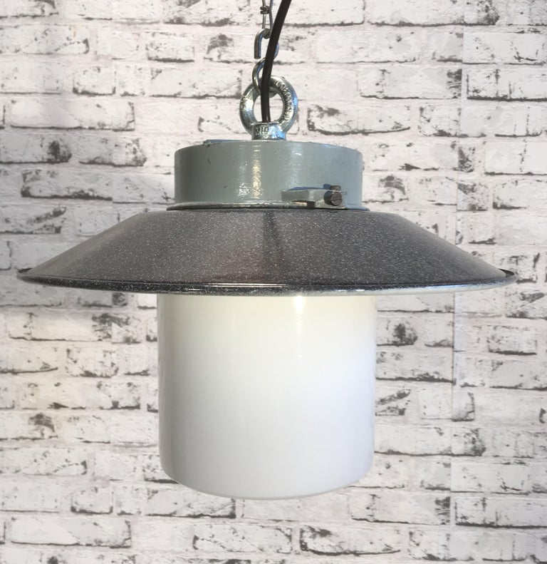 Vintage industrial lamp from 1970s. Cast aluminium top. Enemal shade. Milk glass. New porcelain socket E 27 and wire. Weight: 2 kg.