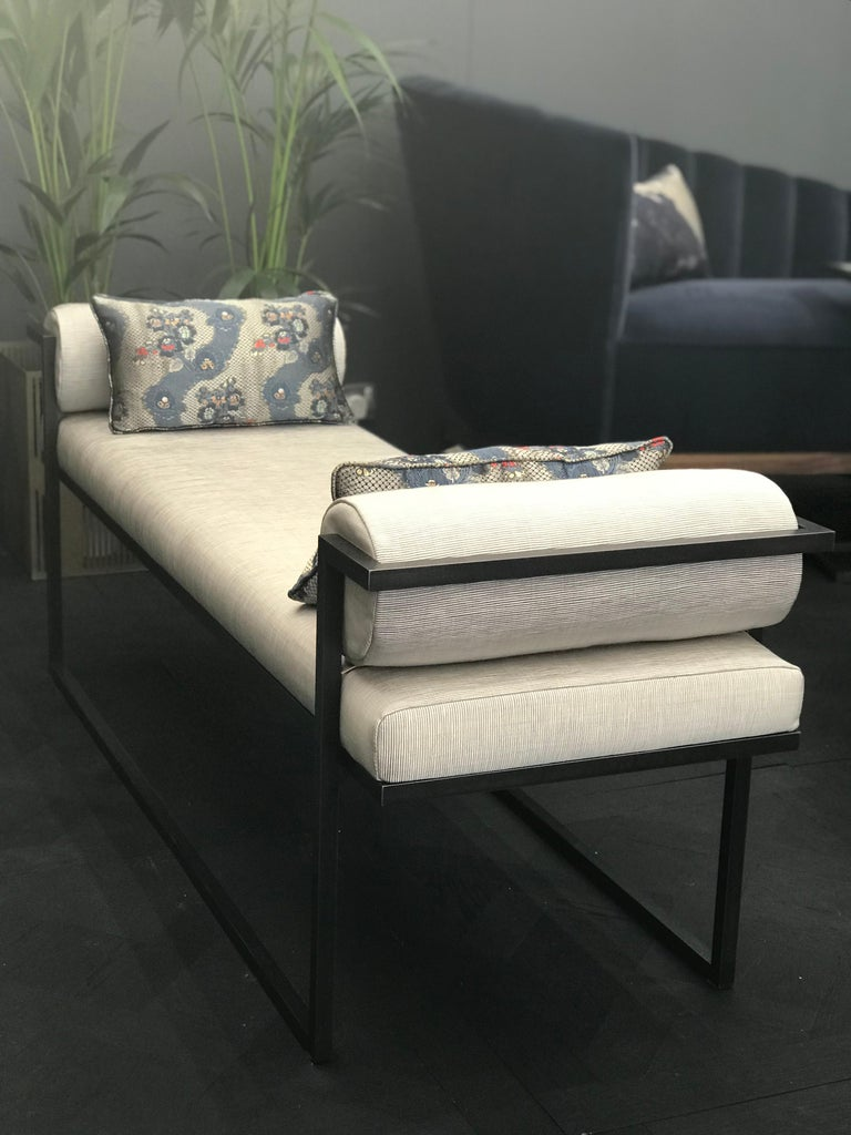 Named after the Greek god of sexual attraction, the Eros bench will visually seduce with its architectural lines and demanding presence. Made from blackened steel and upholstered in one of Casa Botelho's luxe fabrics, the Eros bench is an ideal