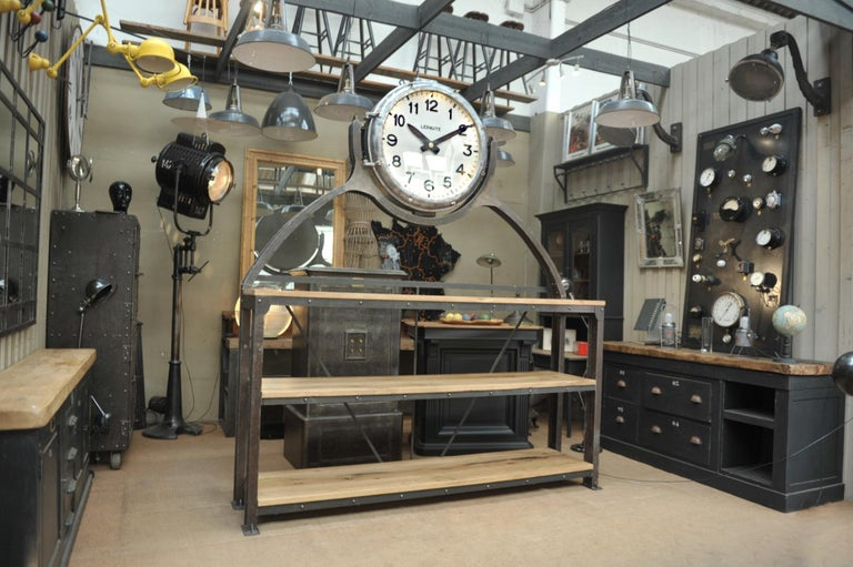Incredible industrial shelf: Very large French Lepaute clock circa 1950 with 5 lights inside rewiered with his original metal frame that was in a Parisian subway entrance, the frame was cut a the base and added in the front to make the legs of the 3