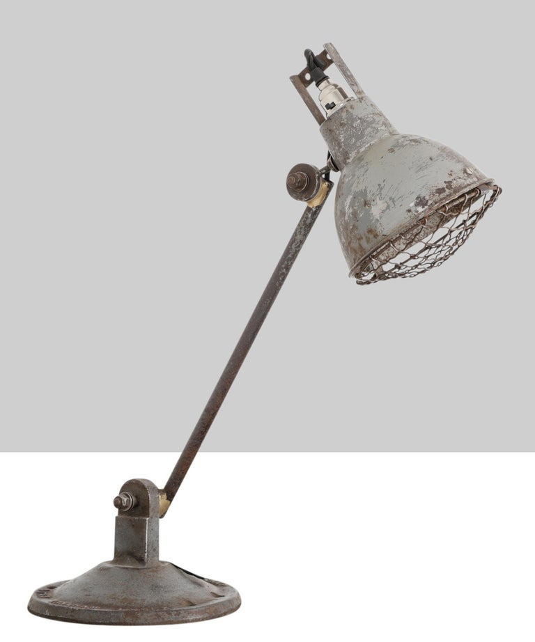 F.E.W. Handy-lamp by Autax Langham Essex. Single arm mounted to a cast iron base with articulating shade.
