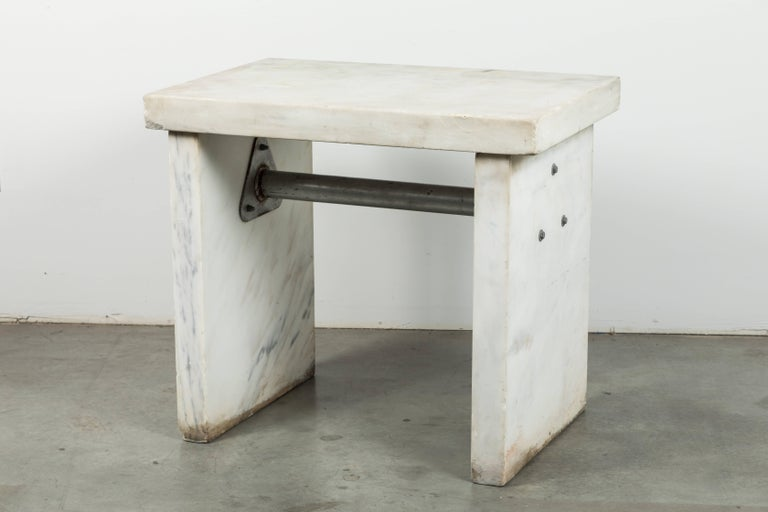 Chunky marble slab table found in the Midwest. Most likely an industrial factory table. Uses could have been for candy making, an industrial bakery or lab. Awesome honed marble with the perfect amount of patina and wear. Functional kitchen work