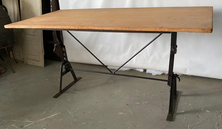 This industrial table base made from a pair of antique saw horses will make a great desk, office, writing table, a dining table in the kitchen, garden, porch or patio. The table has a teak plank top but can be sold separately for you to put a top of