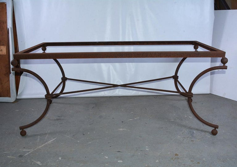 A French vintage iron table base comprised of four curved legs connected by centre X-form reminiscent of neoclassical form. The perfect balance of this classical yet Industrial piece would work wonderfully for formal dining or for a classy dinner
