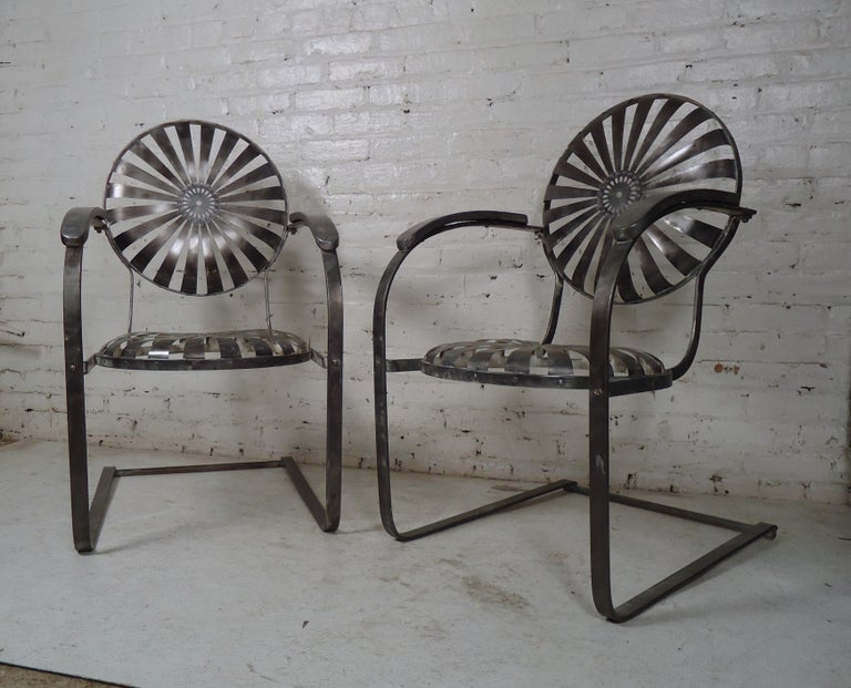 Pair of vintage industrial spring chairs restored in a rough bare metal style finish. Spring base and flexible seat and back provide comfortable seating indoors or out.