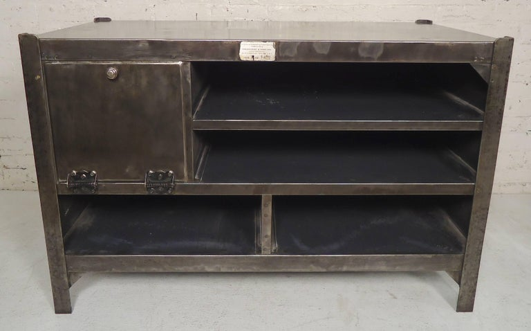 Vintage metal table with cabinet space, refinished in a bare metal style finish. Front has shelving and cabinet storage, the back is solid metal.  (Please confirm item location NY or NJ with dealer).