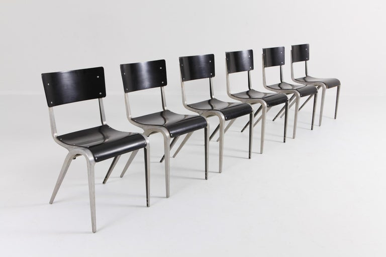 Mid-Century Modern Industrial stacking chairs by James Leonard. Bent plywood seating and cast aluminum frame. UK, 1948 Quite rare to have a dining set of six chairs available  Would fit well in a Jean Prouvé, Wim Rietveld inspired minimal