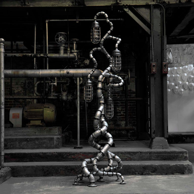 The Tree of Souls  Towering in at over eight feet tall, The Tree of Souls is the most developed and imposing life form found to date in The Industrial Evolution Collection. Extending vertically, initially from six different points of contact, the