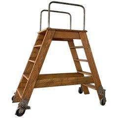 Industrial Oak Rolling A Frame Ladder by Putnam