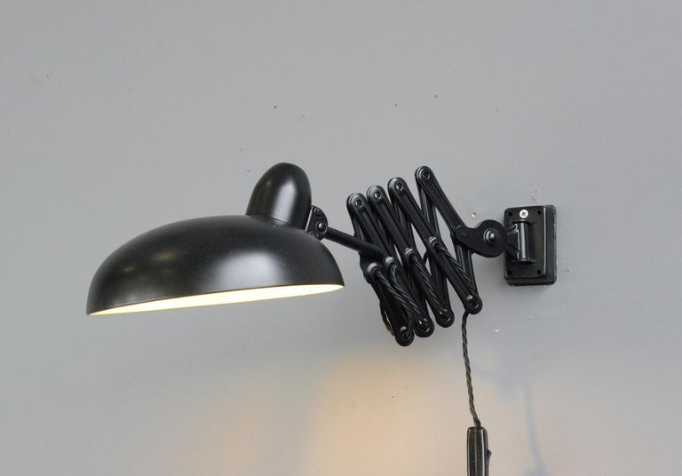 Industrial scissor lamp by Escolux, circa 1930s  - Extendable scissor mechanism - Takes E27 fitting bulbs - On/Off switch on the cable - Made by Schroder & Co. under the Brand name
