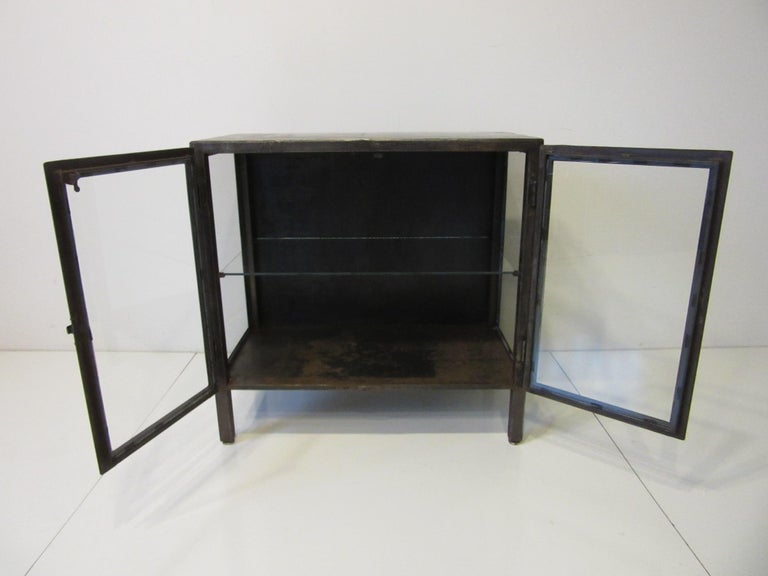 Industrial Steel and Glass Cabinet / Bookcase In Good Condition For Sale In Cincinnati, OH