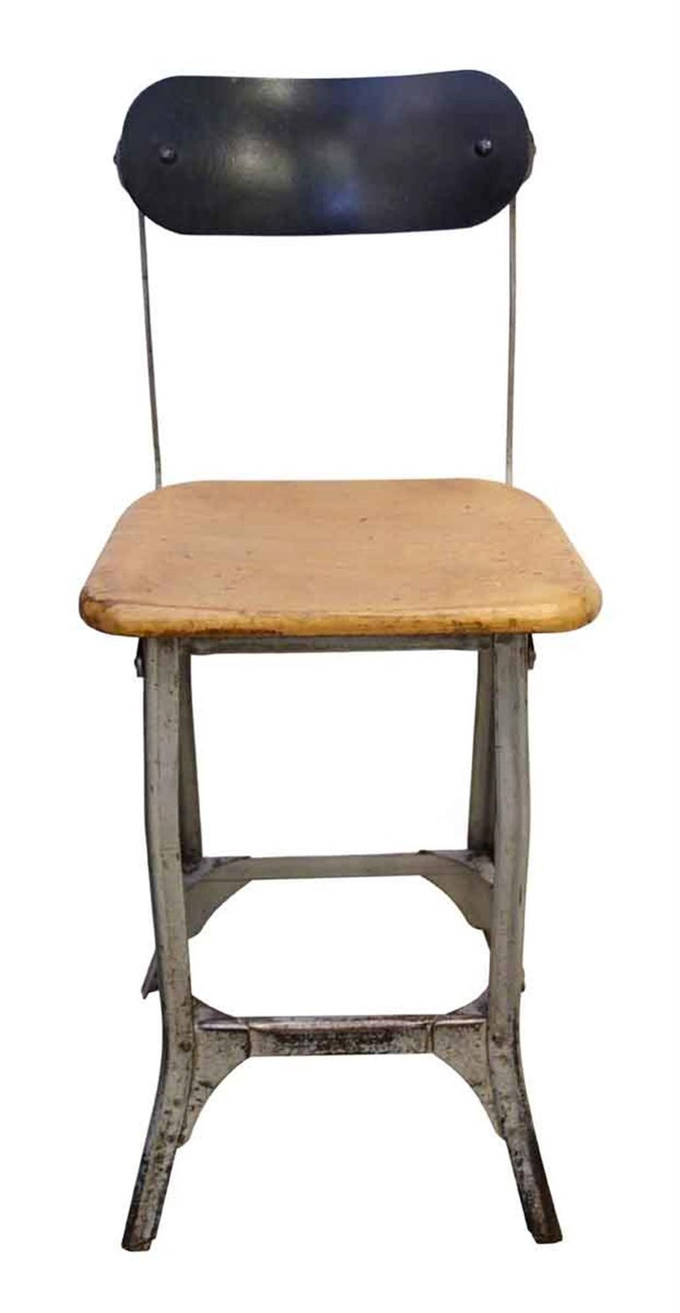 1940s stool with a light wood tone seat and refinished metal back. This has charm and durability! This can be seen at our 5 East 16th St location on Union Square in Manhattan.