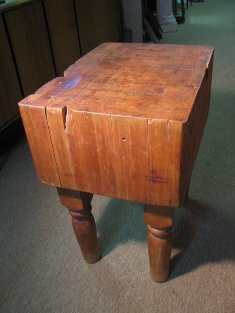 Farm house butcher block table from an upstate New York home. Solid maple with turned legs and just the right patina. Very solid and tight.