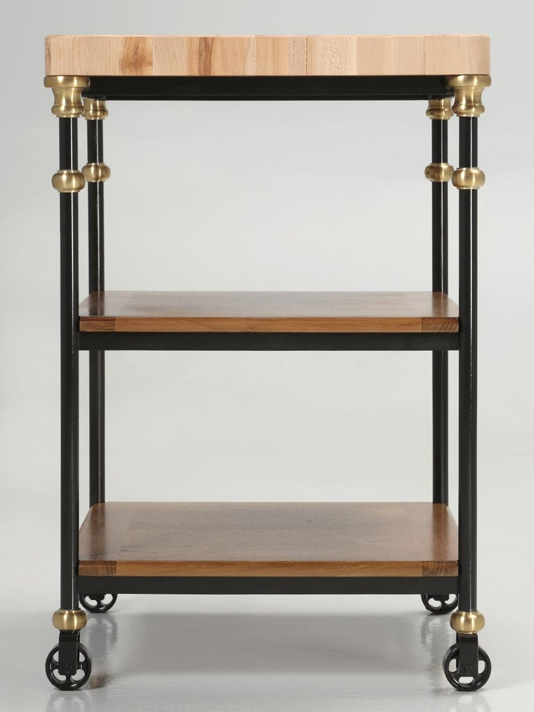 Newly constructed industrial style French Inspired Kitchen Island, made from steel with solid bronze connectors, a solid maple end grain butcher block top and two lower rift-cut white oak shelves. This is another in a long line of our famous Old
