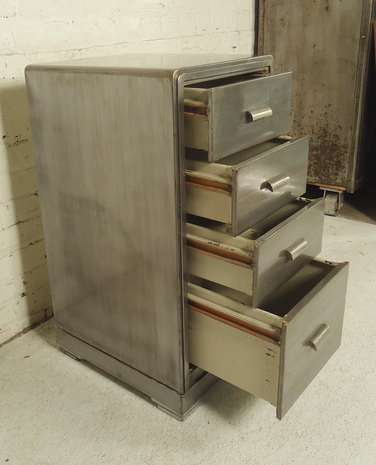Simmons miniature set of drawers restored in a bare metal style finish.