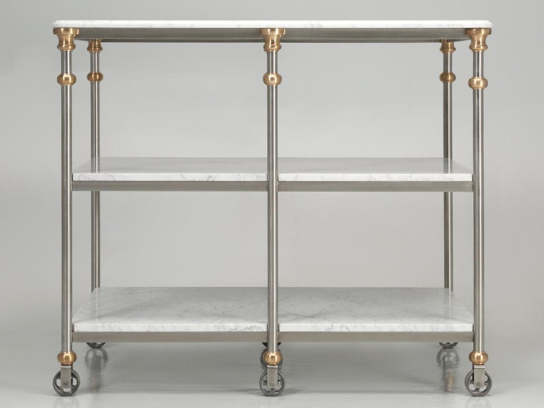 Industrial style stainless and bronze kitchen island with Carrara marble shelves;
