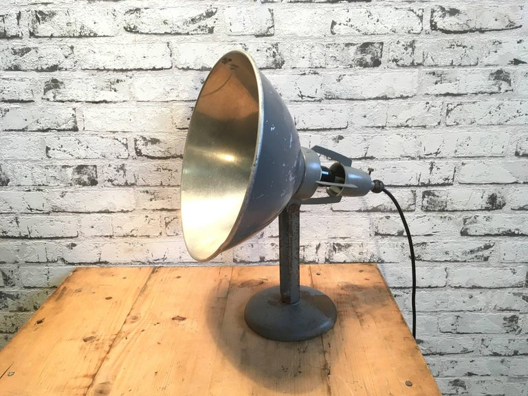 Industrial table lamp manufactured in the 1930s in Switzerland by BAG Turgi. The lamp is made from a steel base and adjustable aluminium shade. New porcelain socket for E 27 lightbulbs. New wire. The diameter of the shade is 28 cm.