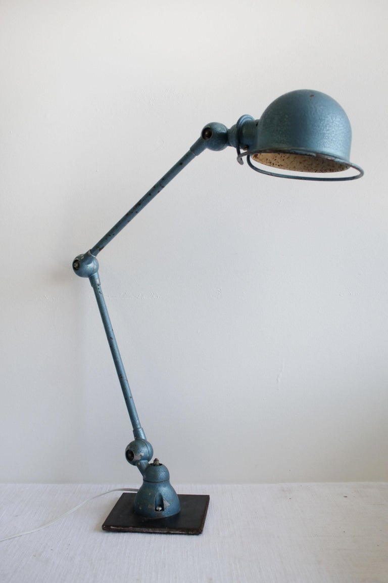 Industrial table lamp in original blue finish Working lamp with industrial style, can be used for everyday. The lamp articulates and can be angled from 3 areas, the base, the center and at the top lamp head. Size:  7