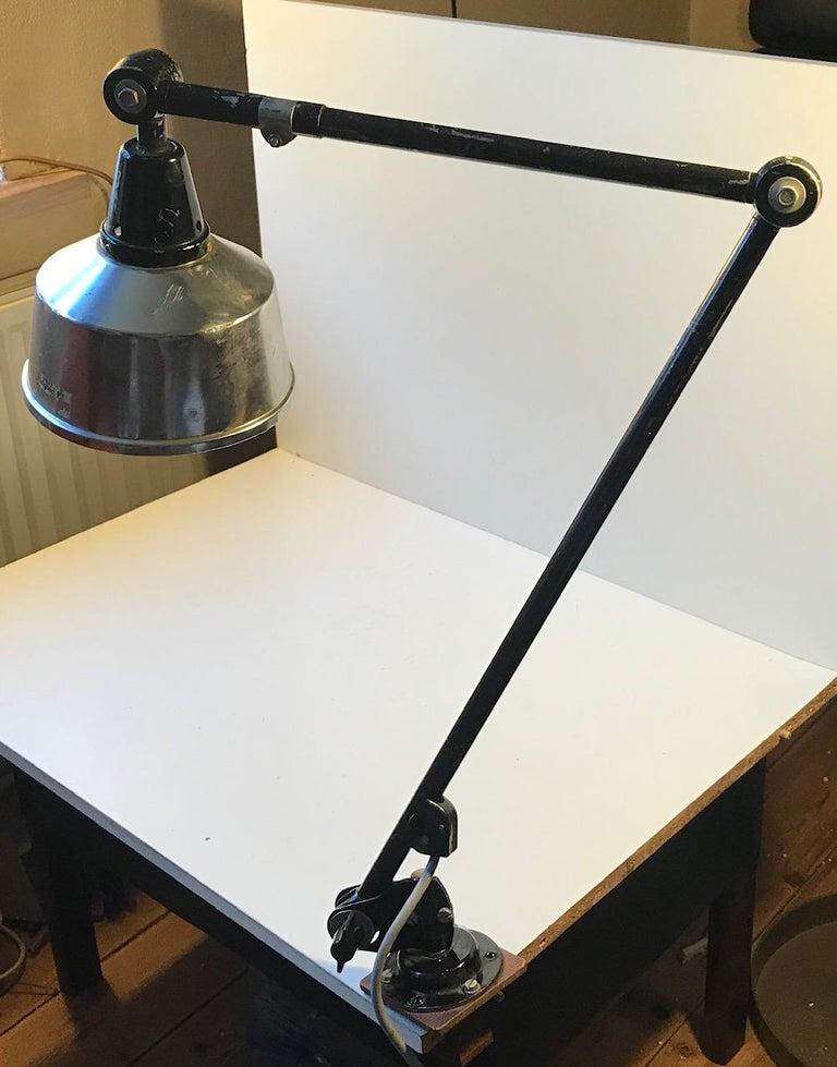 A jointed fully adjustable German table light by Industrial designer Curt Fischer who was hugely inspired by the Bauhaus Movement and Walter Gropius in particular. This light came out of a metal workshop in Germany where it was mounted as a