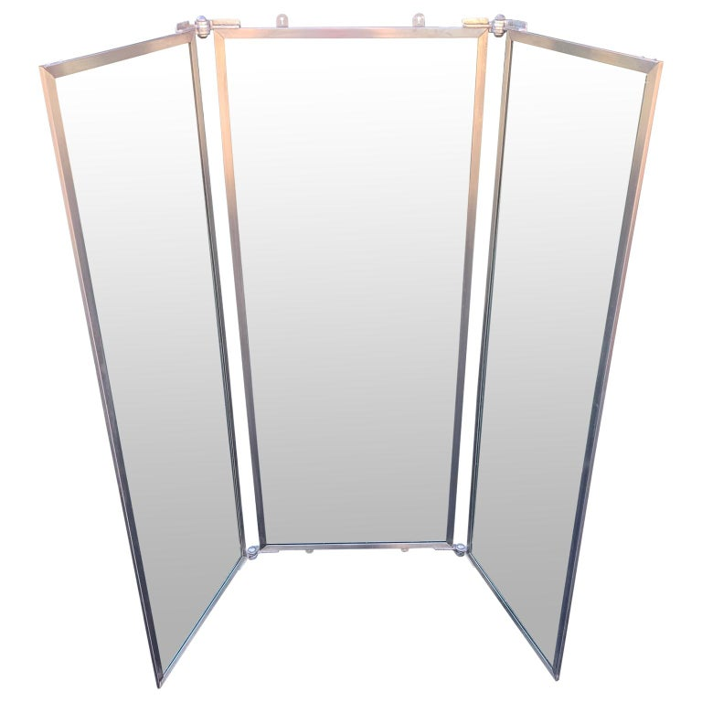 Industrial three-panel mirror and metal folding screen.  Screen measures 22 inches in depth when in horseshoe shape position Each panel measures 20.2 inches in width and 60.2 inches in height Screen measures 49 inches in width when in half open