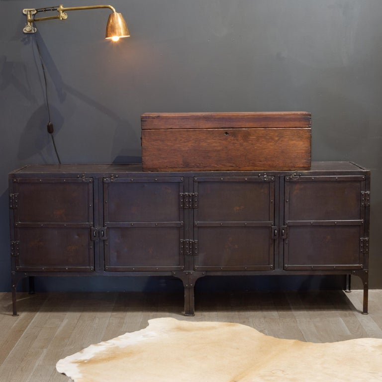 About  A circa 1900 toolbox from a French automobile factory inspired this expanded version, perfectly suited to life as a console or sideboard today.   Handcrafted of iron and held with exposed rivets  A hand-applied, 4-step finishing process