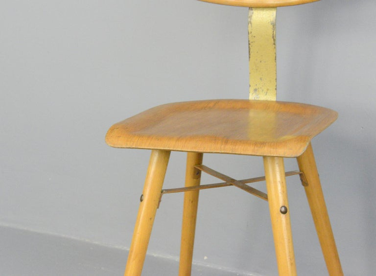 Industrial work stool by Ama, circa 1930s  - Ply seat - Sprung steel back rest - Designed by Albert Menger - Produced by Ama, Nordhalben - German, 1930s - Measures: 39cm wide x 47cm deep x 90cm tall - 52cm seat height  Condition