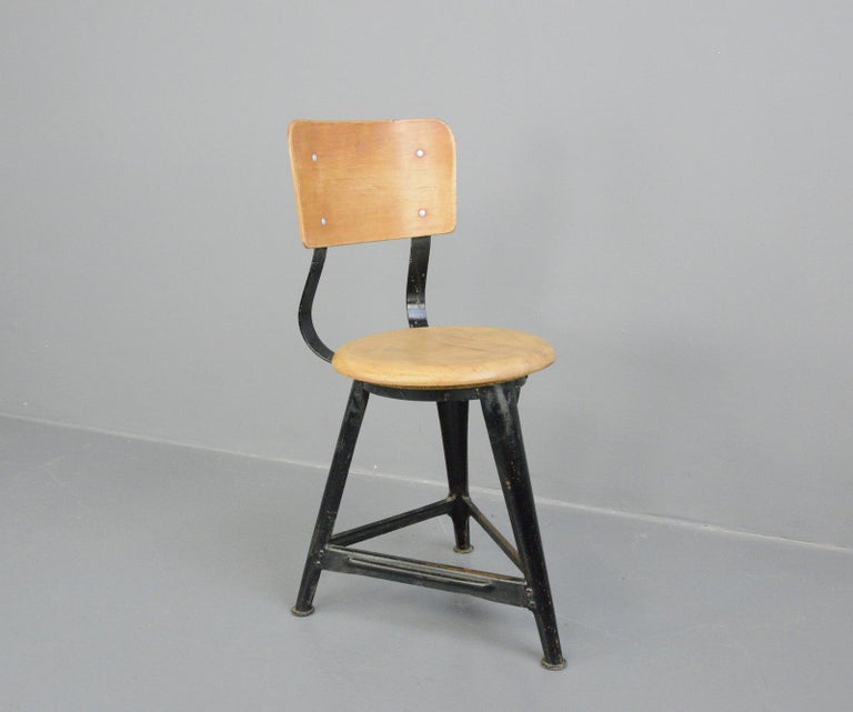 Industrial work stools by Ama, circa 1930s  - Price is per stool - Steel frame - Solid Elm seat with ply backrest - Designed by Albert Menger  - Produced by Ama, Nordhalben - German ~ 1930s - Measures: 35cm wide x 41cm deep  - 46cm seat