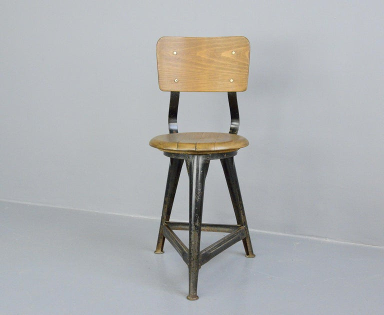 Industrial work stools by Ama, circa 1930s  - Price is per stool - Steel frame - Solid Elm seat with ply back rest - Designed by Albert Menger  - Produced by Ama, Nordhalben - German ~ 1930s - 35cm wide x 41cm deep  - 50cm seat