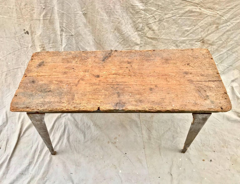 A useful and cool looking Industrial workbench of light steel having an added early 19th century pine top. The top adds a tremendous amount of warmth and patina, and allows the piece to also function as an art studio worktable.