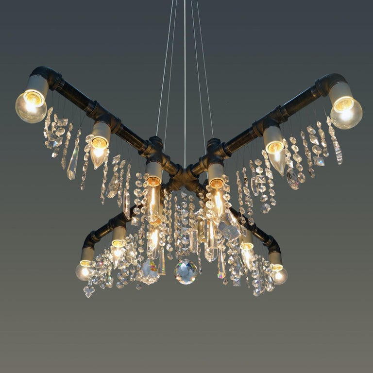 The Industrial 9-bulb compact beacon pendant chandelier is the newest model in our Industrial Collection and one of the most spectacular. At first glance it appears to be a traditional 3-tiered chandelier, though the sparkle will alert you to the