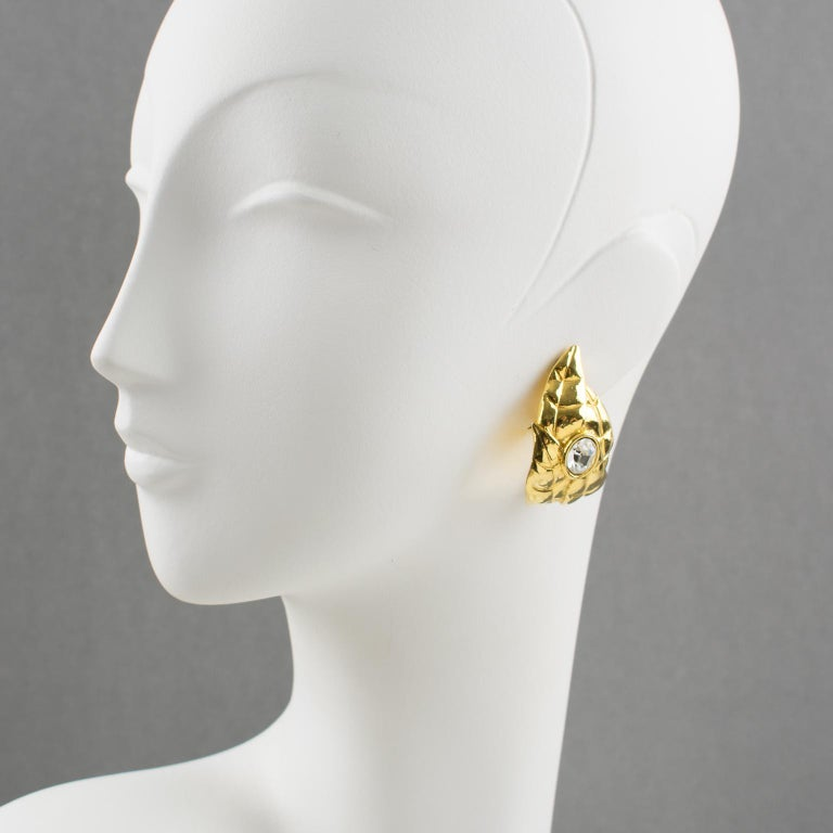 Stunning clip-on earrings by Ines de la Fressange Paris. Hoop shape, with gilt metal all carved and textured featuring oak leaf compliment with a huge clear crystal rhinestone. Signed underside with Ines de la Fressange gilt logo tag: