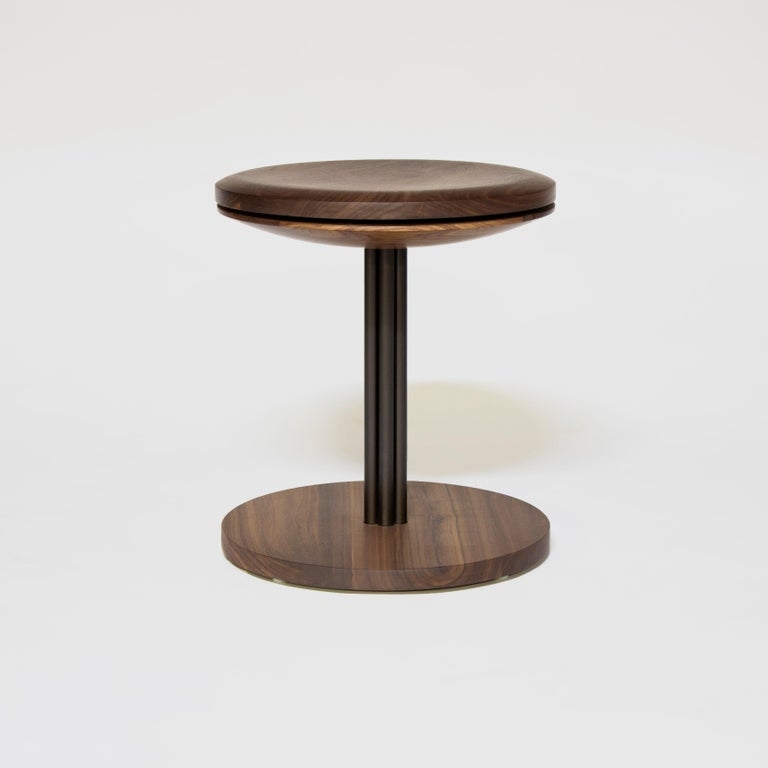 Inez stool by Crump and Kwash   Carved solid wood seat and base / hand rubbed zero VOC oil finish / solid steel construction / 360 degree rotating seat top.   Measures: Height 18in  Diameter 16in.   Wood options: Maple, blackened oak, walnut, white