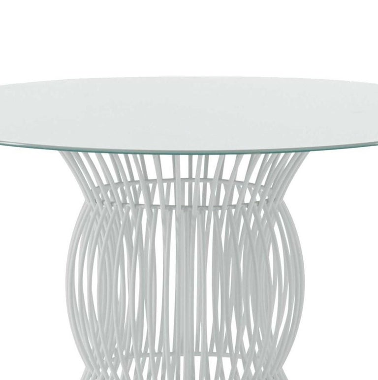 Infinity dining table by Braid Outdoor.