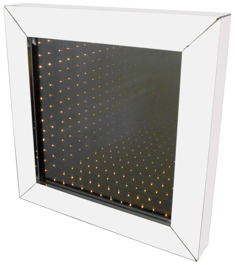 A large and visually alluring infinity mirror in a deep, mirrored box frame. Great scale and construction with a wonderful optical effect, suggesting infinite rows of lit bulbs. A very special decorative accessory that will add another dimension to