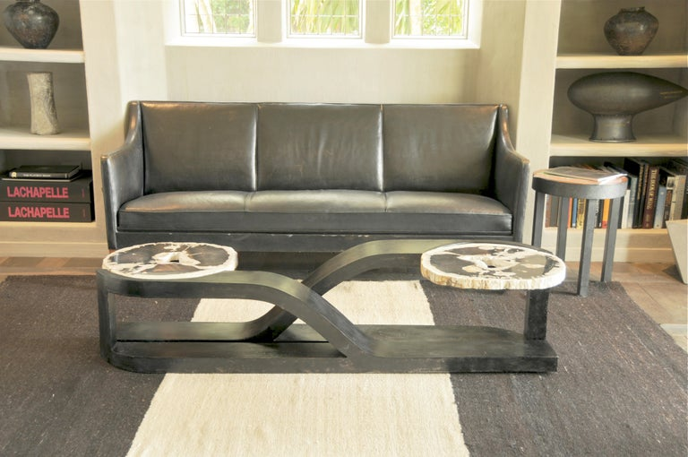 Inspired by our infinite underlying connectedness, this skillfully hand-welded table was designed and built by John Brevard in 2010.  This one of a kind sculptural table combines steel (a product of our tectonic era) and petrified wood (timeless and