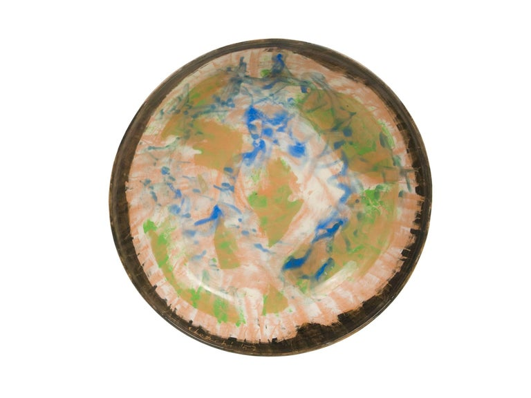 This ceramic plate was painted by Sandro Cherchi for Ceramiche S. Giorgio in the 1957. Edition number 105, signed at the bottom.