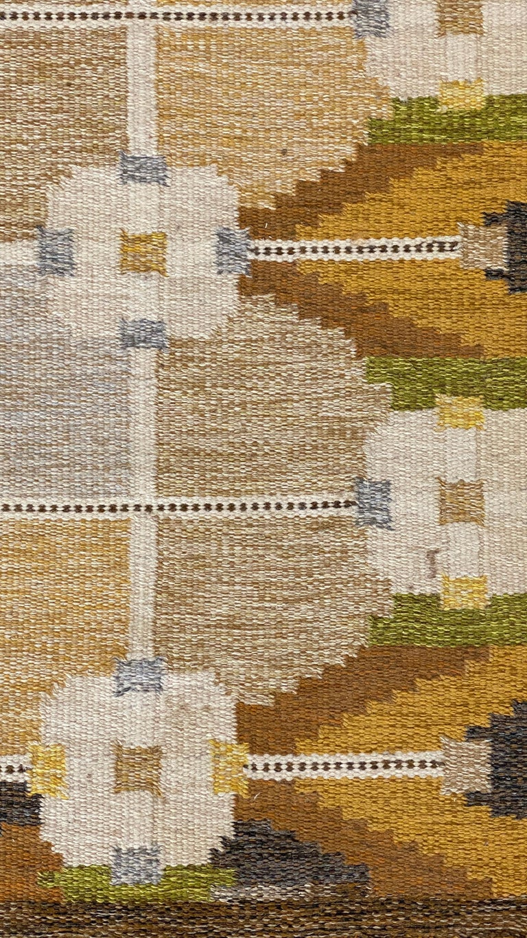 A handwoven modernist flat-weave carpet / rug by Ingegerd Silow. Most likely woven in the 1950s. Handwoven in wool, using a Kilim technique. Signed  Follows a lineage of Modernist rugs produced in Sweden throughout the 20th century. Other artists
