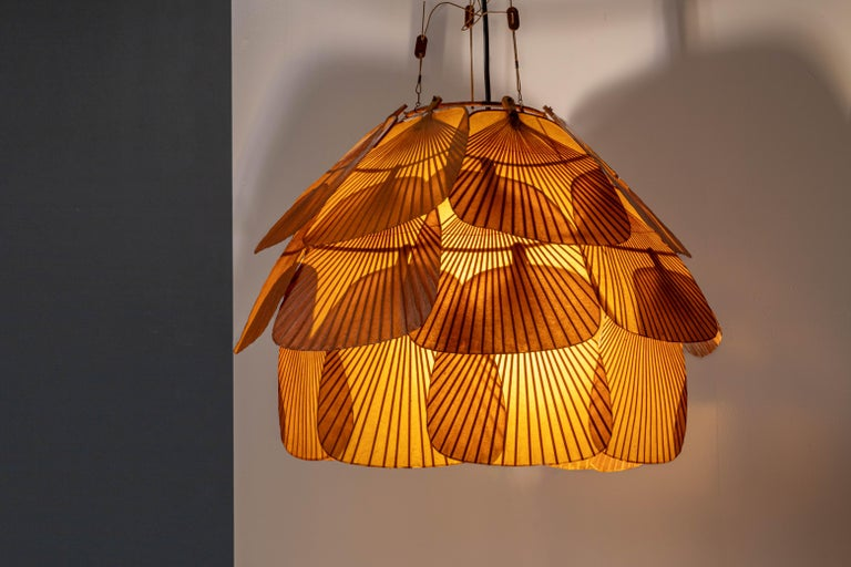 Splendid version of the rare Uchiwa Fan lamp by Ingo Maurer. We have seen many Ingo Maurer lamps but this one is stunning. It has such an amazing patina due to its age, only reachable by keeping this in a dark spot all those years, without any