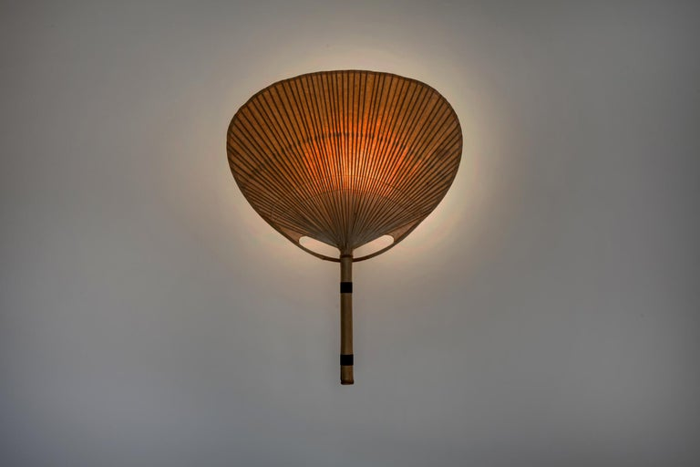 Appliqué 'Uchiwa III', created by Ingo Maurer for Design M. Bamboo, rice paper and black lacquered metal suspension.