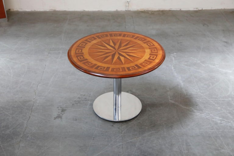 A wonderful dining / cafe table featuring inlaid marquetry wood with Greek key and nautical designs. Would also work wonderful as a center table. 40