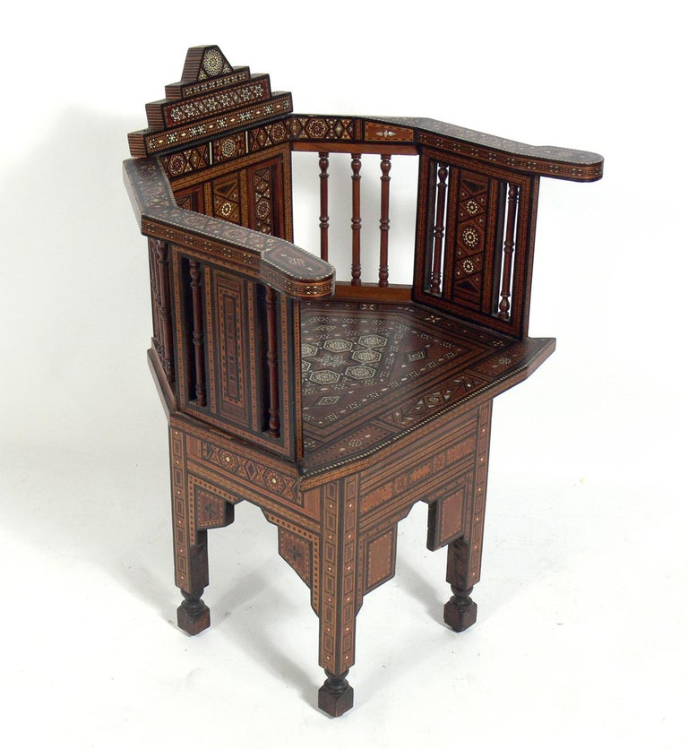 Inlaid Moroccan chair, in the manner of Carlo Bugatti, Moroccan, circa 1950s. Completely hand made with intricate inlay throughout. Retains warm original patina.
