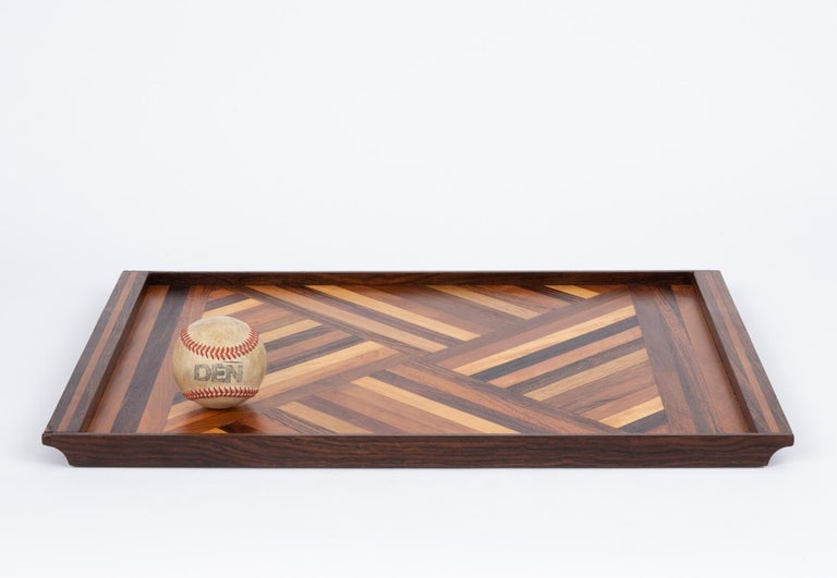 Always interesting and never boring, here we present to you Don Shoemaker's rosewood detailed serving tray for his company Señal in the 1960s. Shoemaker is known for the marquetry in his tray's- I don't think we've ever had two of the same come in,