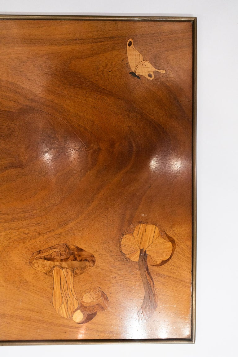 Beautifully executed inlaid wooden panel or table top with mushrooms and a butterfly. This piece was originally sold in the Christian Dior