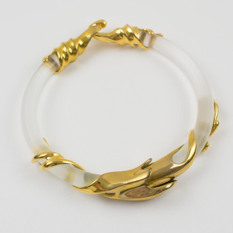 Outstanding sculptural Lucite choker necklace by Inna Cytrine Paris. The bold rigid collar necklace is fully articulated. Futurist gilt bronze metal embellishments wrap around the frosted lucite band. Fits very nicely around the neck. Large hook