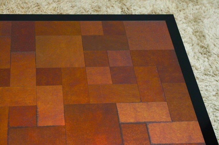 Inox 1970s coffee table. Black laminated base and on top a nice simple graphical artwork. Measures: Width 90 cm.